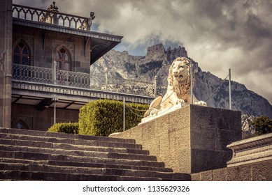Crimea - May 20, 2016: Vorontsov Palace with a stone lion in Crimea, Russia. Vorontsov Palace is one of the main landmarks of Crimea. Vintage architecture of Russian Empire in South Crimea in summer.