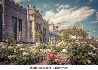 Crimea - May 20, 2016: Vorontsov Palace with a flower garden in Crimea, Russia. It is one of the main landmarks of Crimea. Scenic view of the old Russian palace in arabic style on the Crimea coast.