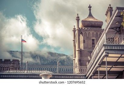 Crimea - May 20, 2016: Vorontsov Palace close-up in Crimea, Russia. Old Vorontsov Palace is one of the main landmarks of Crimea. Historical architecture of South coast of Crimea with a Russian flag.