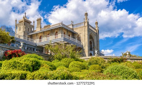 Crimea - May 20, 2016: Vorontsov Palace with beautiful landscape garden in Crimea, Russia. It is one of the main landmarks of Crimea. Panoramic view of historical architecture of Crimea in summer.