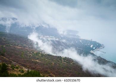 Crimea peninsula, Black Sea. Coastal landscape of Laspi district in foggy spring cloudy day