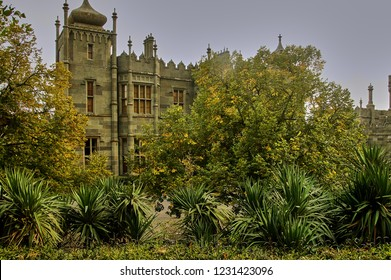 Crimea, Russia -12 October, 2014: View of the Vorontsov Palace from Alupka Park. In the foreground - evergreens. The yard itself is hidden by greenery. Crimea.