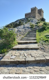CRIMEA, RUSSIA - Ancient stone steps to the upper level of the Genoese fortress of Sudak consisting of Consular castle and four neighboring towers connected by walls.