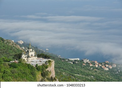 CRIMEA, RUSSIA - Foros Church Over the Clouds. View from Baidarsky Pass on the Church of Christ's Resurrection raising on the Red Cliff (Krasnaya Skala)