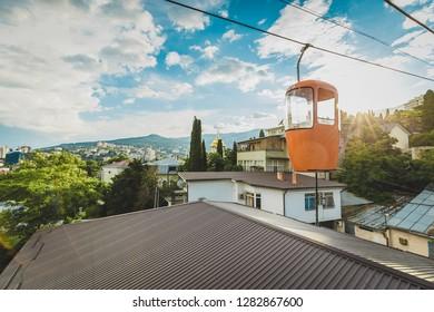 Crimea, Yalta. Orange funicular cabin and aerial city skyline panoramic view