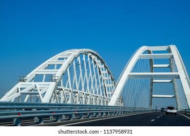 Crimean bridge, Taman, Russia - July 9, 2018: The navigable arch of the Crimean bridge. Arch of the highway and railway section of the Crimean bridge. Driving along the Crimean bridge. A grandiose
