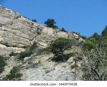 Crimean mountains, steep stone ridge, steep slopes