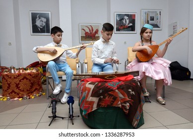 Crimean Tartar boys and girl in a native costumes playing music during traditional wedding ceremony. Days of Crimean Tartar culture. February 27, 2019. Kiev, Ukraine