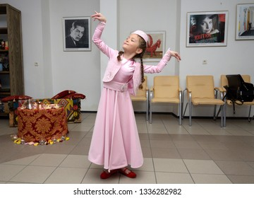 Crimean Tartar little girl in a native dress dancing during traditional wedding ceremony. Days of Crimean Tartar culture. February 27, 2019. Kiev, Ukraine
