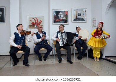 Crimean Tartar musicians in a native costumes playing music during traditional wedding ceremony. Days of Crimean Tartar culture. February 27, 2019. Kiev, Ukraine