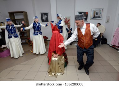 Crimean Tartar traditional wedding ceremony: a groom dancing with a bride during their meeting. Days of Crimean Tartar culture. February 27, 2019. Kiev, Ukraine