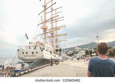 Crimean, Yalta June 20 2019. People walk along the embankment of Yalta, ship Chersonesos