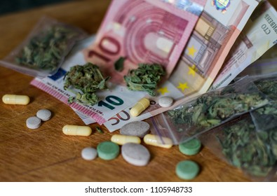 criminal business of drug trafficking. euros and hryvnia illegal. Tablets, pills and cannabis lie on cash. money