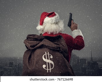 Criminal disguised as Santa Claus holding a gun and carrying a sack full of stolen money, he is robbing houses on Christmas Eve's night, cityscape on the background