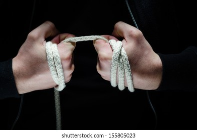 Criminal hands holding a rope