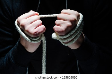Criminal hands holding a rope