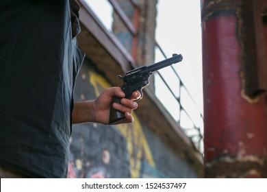 criminal holding a gun replica at gunfight