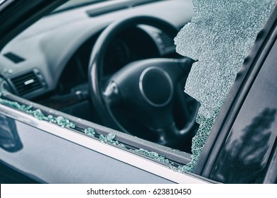 A criminal incident. Hacking the car. Broken left side window of a car