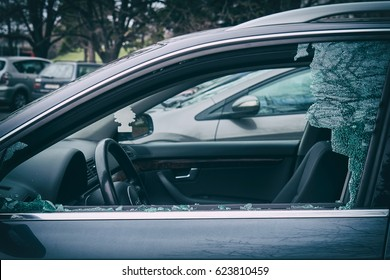 A criminal incident. Hacking the car. Broken left side window of a car