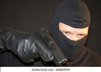 criminal Man with gun and mask with black background
