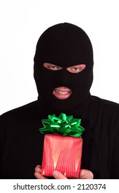 Criminal series 9 - masked bandit holding a wrapped Christmas gift