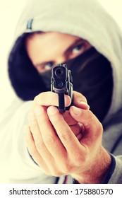 Criminal theme - masked man with gun