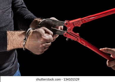 criminals that try to break handcuffs with a big pair of shears