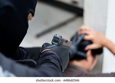 The criminals use guns pointed head hostage,selective focus