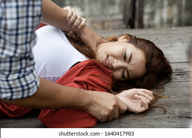 Criminals use hand strangle to attack woman,and bully with violence , life is in danger, torture and panic, victims of domestic violence, cruelty, violence, attacks and crimes in society.