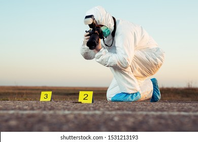 Criminological expert collecting evidence at the crime scene.