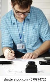 Criminologist in office after checking fingerprints
