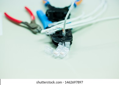 Crimper and wire cutter isolated on a white background. Twisting Cable Tool Twisted Pair Ethernet UTP Cat 5, Crimping RJ45 LAN cable, Stepping to crimping RJ45 connector.
