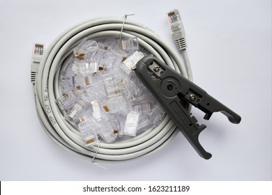 Crimper and wire cutter isolated on a white background. Twisting Cable Tool Twisted Pair Ethernet UTP Cat 5, Crimping RJ45 LAN cable, Stepping to crimping RJ45 connector