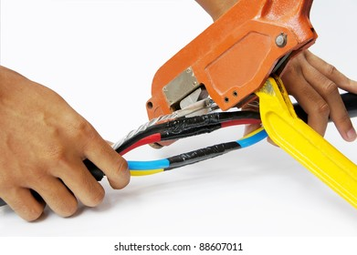 crimping power cable on isolated white background