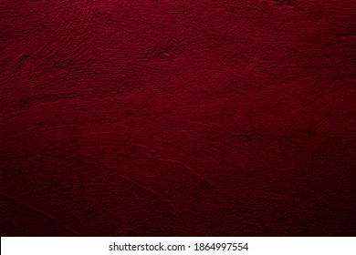 Crimson colored wall background with textures of different shades of red