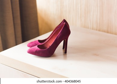 crimson shoes on high heels