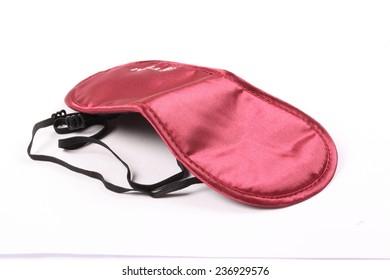 Crimson sleeping mask isolated on white background