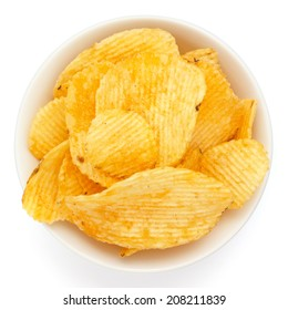 Crinkle cut crisps in a white bowl on white background.