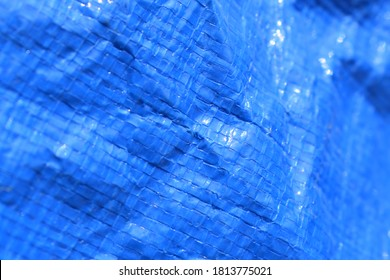 Crinkled Blue Tarp Damaged And Faded
