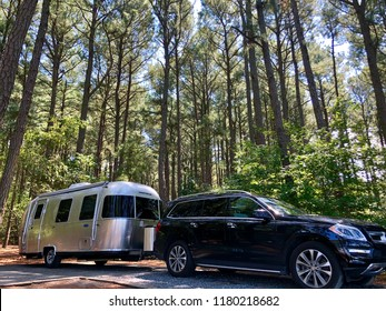 CRISFIELD, USA - SEPTEMBER 3, 2018: Am airstream travel trailer parked at Janes Island State Park, MD, USA.