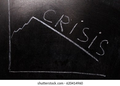 Crisis Concept.Crisis on Dark Background.chalk on a blackboard.graph down.
