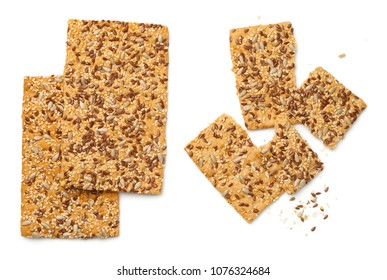 Crisp bread with linseed, sesame and sunflower seed isolated on white background. Top view