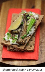 Crisp bread toasts with smoked sprats