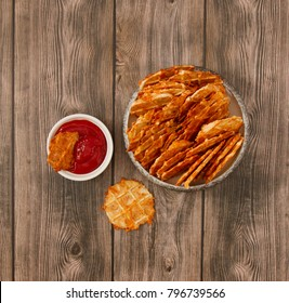 Crisp cheese waffles on wooden background