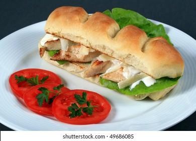 crisp chicken burger with tomato onion cheese lettuce