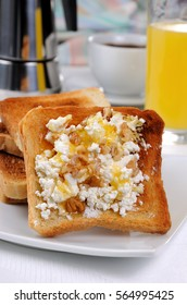 Crisp, fresh  toast ricotta, honey and nuts for breakfast with orange juice and coffee