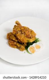 Crisp fried shrimps tempura with egg. Seafood tempura cuisine dish.