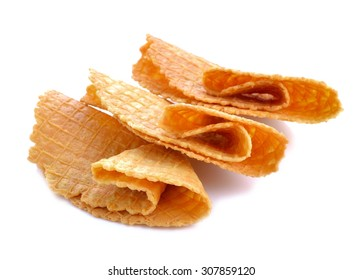 Crisp golden waffle  biscuits used for garnishing desserts on a white background