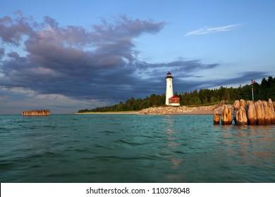 Crisp Point Lighthouse. Image of the Crisp Point Lighthouse at sunset.