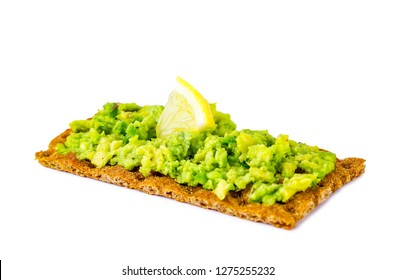 Crisp rye bread with avocado cream isolated. Avocado sandwich on a white background